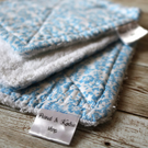 Set of 3 dish cloths in floral blue cotton fabric and white terry cloth backing.