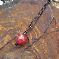 Autumn pendant necklace in oxidized silver; fire agate pendant