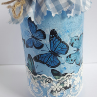Blue butterfly storage jar.