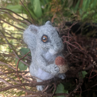 Needle felted small Squirrel holding nut