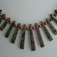 Beautiful freshwater pearls with ukanite, copper and silver