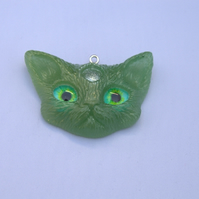 Green three eyed kitty