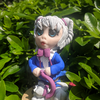 Alice with dog polymer clay figure