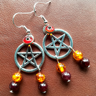 'Fire Desire' pentacle earrings with amber and garnet.