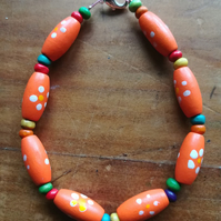 Orange wooden bead bracelet - small size.