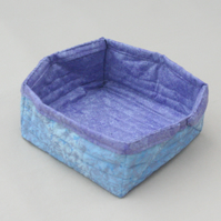 Quilted storage box featuring glittery blue and purple fabric.
