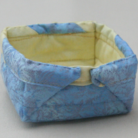 Small Quilted storage box featuring glittery blue and yellow fabric.