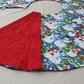 Christmas Tree Skirt with Snowman patterned fabric and ribbon ties.