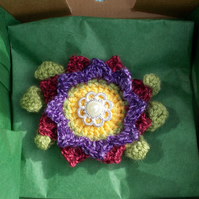 Crochet flower brooch, corsage shades of burgundy and purple.