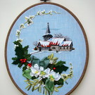 Hand embroidered winter scene Christmas decoration. Embroidery art.