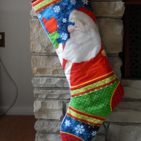 Christmas quilted stocking made from Santa Christmas print.
