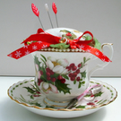 Tea Cup and Saucer Pin Cushion. Royal Albert Christmas Rose Design.