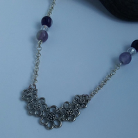 Silver Tone Flower Pendant with Purple Glass Beads