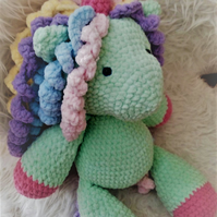 Large unicorn crochet amigurumi toy.