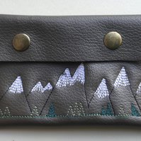 Small embroidered leather purse