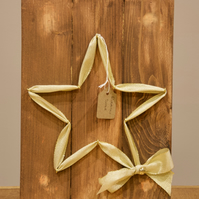 Gold star wall decor on solid wood background