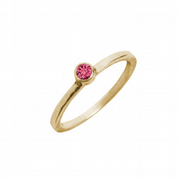 Solid 9ct gold ring with a red topaz