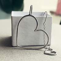 Asymmetric oversized heart earrings