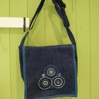 Denim messenger bag with embroidery