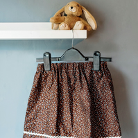 Floral children's skirt with ribbon, size 2-3