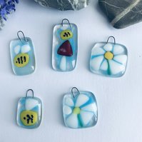 Fused glass sun catchers of bees and flowers