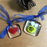 Small fused glass sun catchers of bee and heart.