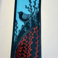 stained glass panel of a bird on a branch
