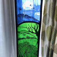 stained glass panel depicting a countryside view