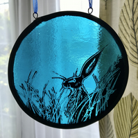 stained glass panel of a hare, blue, circle, wildlife art