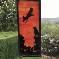 Crow stained glass panel