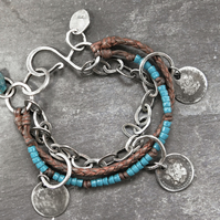 Silver Coin Bracelet Layered with Leather and Beads