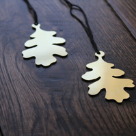 Pair of hand sawn brass oak leaf decorations