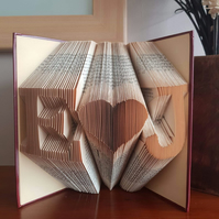 Folded book art, initials with heart