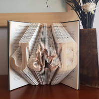 Folded book art, initials with ampersand