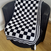 "Corner to corner black and white with tassels throw. Size 54"" by 50""."
