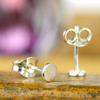 Tiny sterling silver dot earrings