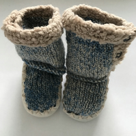 Hand knitted boots with fur lined soles
