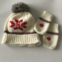 Hand knitted baby pompom hat and mittens with snowflake design