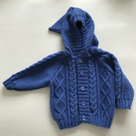 Hand kniited baby jacket with hood