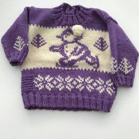Hand knitted baby jumper with snowman design