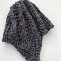 Hand knitted baby hat with earflaps