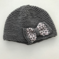 Hand knitted baby cloche hat with bow
