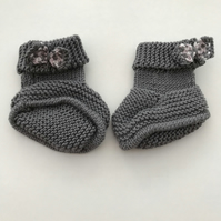Hand knitted baby boots with bows