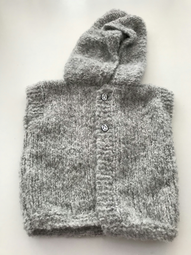 Hand knitted baby hooded gilet