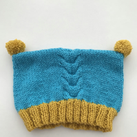 Hand knitted baby hat with pompoms