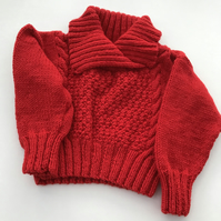 Hand knitted toddler jumper with a shawl collar