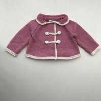 Exquisite pink baby jacket in a luxury yarn