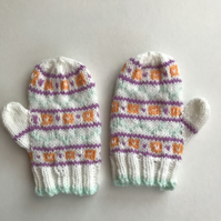 Fair isle pattened baby mittens with thumbs.