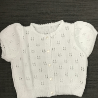 Short sleeved patterned baby cardigan