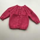 Bright pink cardigan with patterned yolk